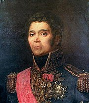 Painting of a man with curly hair, round eyes, and sideburns. He wears a high-collared blue uniform loaded with military decorations.