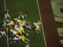 American football players running a running play.