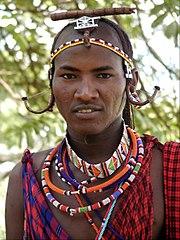 Kenyan man wearing tribal beads.