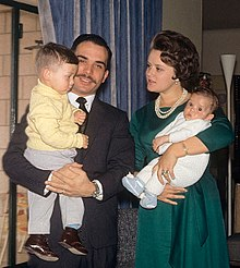 A young King Hussein and Princess Muna, holding their two young sons