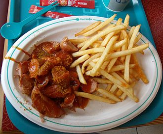 Kochlöffel - Currywurst meal served at Kochlöffel in 2012. The chain's signature spoon can be seen on the top left.