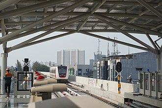 Jakarta LRT - Hyundai Rotem LRV leaving Velodrome station during a limited trial run on 7 September 2018
