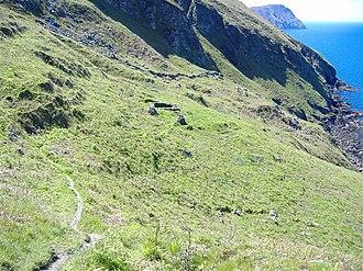 Cronk ny Arrey Laa - Lag ny Keeilley (hollow of the church) on Cronk ny Arrey Laa; the Manx language has had a substantial influence on the island's toponomy and nomenclature.