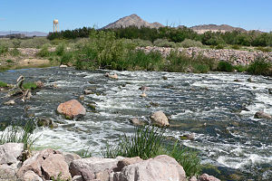 Las Vegas Wash - Heavy flow in spring 2005, with Frenchman Mountain in the background