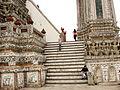 Lascar Damien at the base of the central prang - Wat Arun (4509146925).jpg