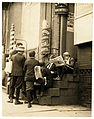 Lewis Hine, Newsboys on a stoop, Wilmington, Delaware, 1910.jpg