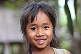 Little girl with white teeth from Don Det in Laos.jpg