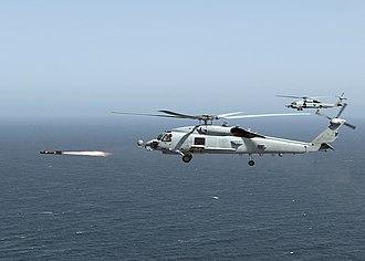 Sikorsky SH-60 Seahawk - An MH-60R Seahawk firing a live Hellfire missile