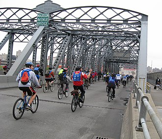 Madison Avenue Bridge - Bicyclists crossing the bridge during the Five Boro Bike Tour