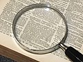 Magnifying glass on the page of a book.jpg