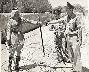 City Line (Jerusalem) - Israeli policemen meet a Jordanian legionnaire near the Mandelbaum Gate. Around 1950