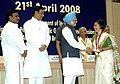 Manmohan Singh presenting the Prime Minister's Award for Excellence in Public Administration for the year 2006-07 to Ms. Jyotsna Sitling, (IFS), at the inaugural session of the 3rd Civil Services Day, in New Delhi.jpg