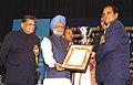 Manmohan Singh presenting the silver trophy to the Managing Director (Rites Ltd.).jpg