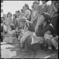 Manzanar Relocation Center, Manzanar, California. Evacuees of Japanese ancestry watching Memorial D . . . - NARA - 538540.tif
