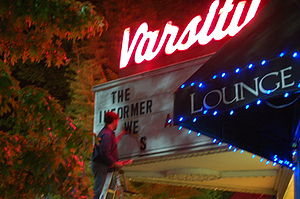 Billing (filmmaking) - Man on a ladder, changing the billing on a marquee in Chapel Hill, North Carolina.