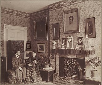 John G. Palfrey - The interior of Mary Ann Hammond's residence at 72 Beacon Street shows her seated with Charles Hammond Gibso and her cat, Topsy, in a richly decorated room
