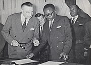 Maurice Yaméogo and Louis Jacquinot exchanging instruments of ratification for the independence of the Upper Volta