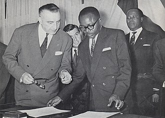 Burkina Faso - Maurice Yaméogo, the first President of Upper Volta, examines documents of ratifying the country's independence in 1960