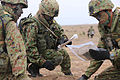 Members of the Japanese Ground Self-Defense Force look at their maps to determine the best way to seize their objective during a patrolling exercise at Marine Corps Base Camp Pendleton, Calif., June 12, 2013 130612-M-JU912-021.jpg
