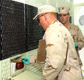 Members of the Navy Provisional Guard Force at Guantanamo Bay, Cub, pass food to a detainee in a cell through a slot.jpg
