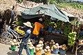 Men selling pumpkins and banana in street.jpg