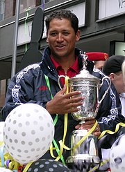 Michael Campbell holding U.S. Open Trophy