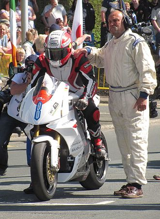 MotoCzysz - Michael Rutter about to start the one-lap TT Zero race at the 2013 Isle of Man TT races on the MotoCzysz E1pc
