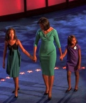 Family of Barack Obama - From left to right: Malia, Michelle, and Sasha on stage at the 2008 Democratic National Convention