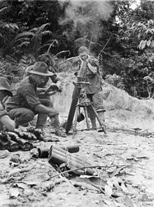Soldiers operating a mortar amidst a jungle scene