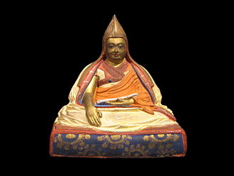 Buddhist ethics - Statue portrait of 5th Dalai Lama.