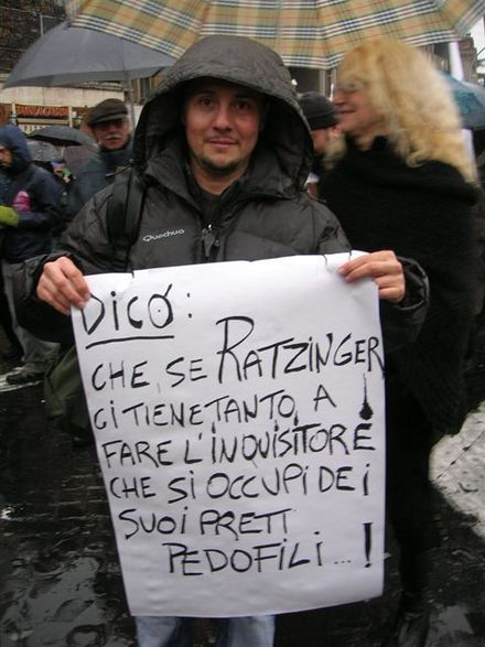 Rome, 2007. March organized by Facciamo Breccia against the interference of the Catholic Church in Italian Politics. The placard says: If Ratzinger really wants to play inquisitor that much, why doesn't he go deal with his pedophile priests? NO VAT 2007 Roma.jpg