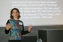 Nancy Baym in front of a slide discussing LastFM