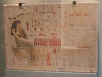 Ancient Egyptian mathematics - Slab stela of Old Kingdom princess Neferetiabet (dated 2590–2565 BC) from her tomb at Giza, painting on limestone, now in the Louvre.