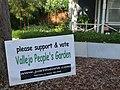 Neighbors & volunteers post yard signs (4704284515).jpg