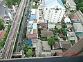 Old Buildings surrounded by Modern Building in Bangkok - panoramio.jpg