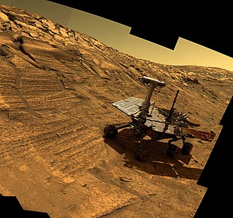 Opportunity mission timeline - Artist generated view of Opportunity, in a real image taken by said rover of a crater