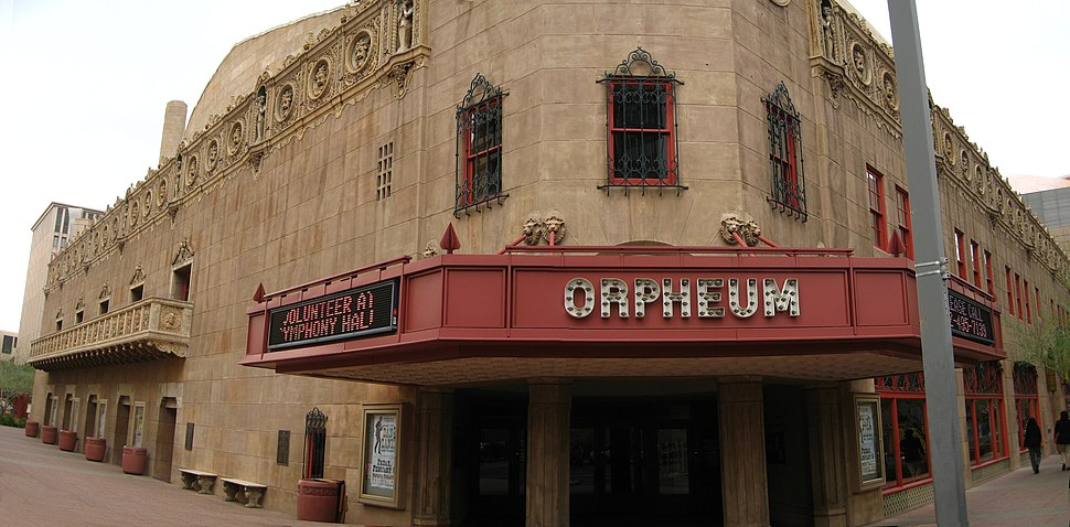 photo of the front entrance of the Orpheum theater, with the red marquee clearly displaying the Orpheum name, contrasted with the pale brown of the stone building