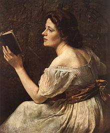 Portrait of a dark haired young woman turned away and reading a book, her dress being cut low, exposes her shoulders and upper back.
