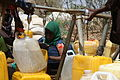 Oxfam East Africa - Newly arrived refugees collect water from Oxfam taps.jpg