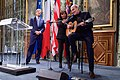 Paris Mayor Hidalgo Gives Singer Taylor a Hand After Amp Fails During Tribute to Shooting Victims (16105973548).jpg