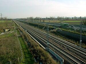 Milan–Bologna high-speed railway - The high-speed line next to the Autostrada A1 near Pieve Fissiraga