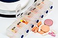 Pill Organizer With Vitamins And Medicines.jpg