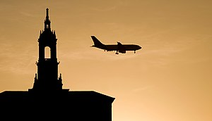 The sunset silhouettes a FedEx plane and the B...
