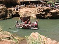 Platform boat carrying tourists at the base of Ouzoud Falls (El-Abid River gorge), Morocco.jpg