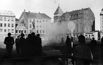 1949 anti-NATO riot in Iceland - Policemen in gas masks guard Austurvöllur after dispersing the crowd with tear gas