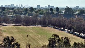 Will Rogers State Historic Park - Polo field and downtown Los Angeles from the park