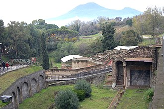 Pompeii - View from Porta Marina showing cliffs on city edge and Suburban Baths
