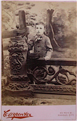 Portrait of boy by Carpenter of Main Street in Kansas City USA.png