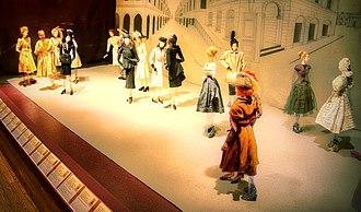 Théâtre de la Mode - Théâtre de la Mode exhibit of doll-like mannequins wearing 1946 French couture clothing and accessories.