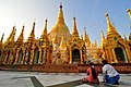 Praying couple @ Shwedagon (4361022275).jpg